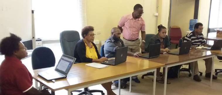 CAPTION: Participants in Papua New Guinea learning how to use video conferencing tools ahead of a Digital Transformation Centre training. Photo credit: ITU